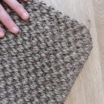 Antiqe Bronze Rug with Rolled Edges on Underlay